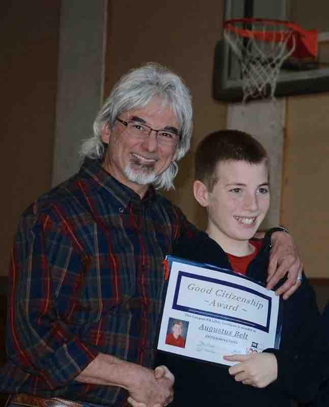 Gus getting an award with his 5th grade teacher